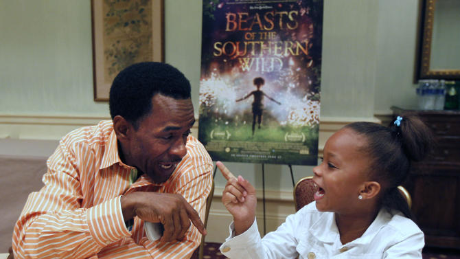 "Actors Dwight henry, left, and Quvenzhané Wallis, first time actors who play the starring roles in the movie ""Beasts Of The Southern Wild,""  speak during an interview in New Orleans, Monday, June 25, 2012. (AP Photo/Gerald Herbert)"