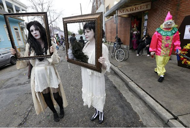Babbette Hines, left, and Carol Jean Dixon, both of New Orleans, pose with their costumes representing sad ladies of the night, inspired by Storyville photographer E.J. Bellocq, before the start of th