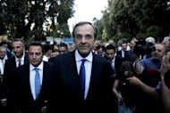 Greece's new Prime Minister Antonis Samaras (C) is seen in Athens on June 21, 2012. Samaras must face a crucial audit by Greece's creditors this week and may be tempted to push a change of rescue terms more in line with what was recently offered Spain
