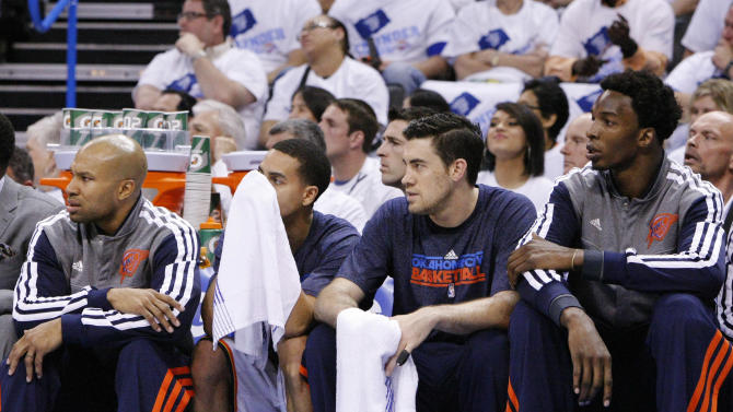 From left, Oklahoma City Thunder's Derek Fisher, Kevin Martin, Nick Collison and Hasheem Thabeet watch during the first half of Game 5 of an NBA basketball playoffs Western Conference semifinal against the Memphis Grizzlies, in Oklahoma City, Wednesday, May 15, 2013. (AP Photo/Alonzo Adams)