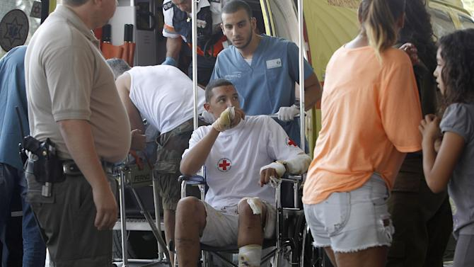 An Israeli man wounded in a bombing in Bulgaria that left five Israeli tourists dead on Wednesday is brought to Soroka hospital in the southern city of Beersheva, Israel, Thursday, July 19, 2012. Israeli Prime Minister Benjamin Netanyahu blamed the attack on Iranian-backed Hezbollah, a Lebanese Shiite Muslim guerrilla group, and threatened retaliation. (AP Photo/Tsafrir Abayov)
