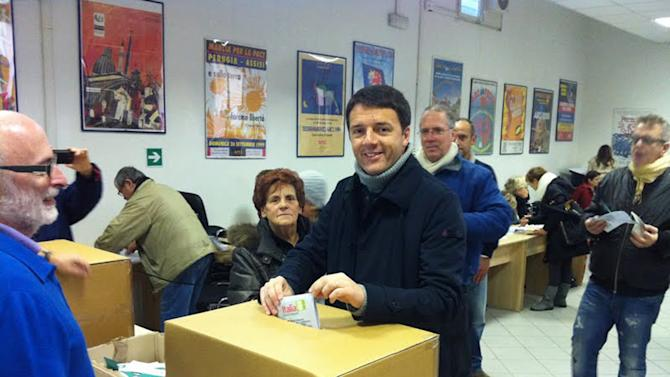 "In this picture made available by Matteo Renzi election committee, Florence's Mayor Matteo Renzi casts his vote during a primary runoff, in Florence, Italy, Sunday, Dec. 2, 2012. Italians are choosing a center-left candidate for premier for elections early next year, an important primary runoff given the main party is ahead in the polls against a center-right camp in utter chaos over whether Silvio Berlusconi will run again. Sunday's runoff pits veteran center-left leader Pier Luigi Bersani, 61, against the 37-year-old mayor of Florence, Matteo Renzi, not shown, who has campaigned on an Obama-style ""Let's change Italy now"" mantra. (AP Photo/Matteo Renzi's election committee)"