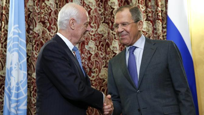 United Nations Special Envoy for Syria de Mistura shakes hands with Russia's Foreign Minister Lavrov before their meeting in Moscow