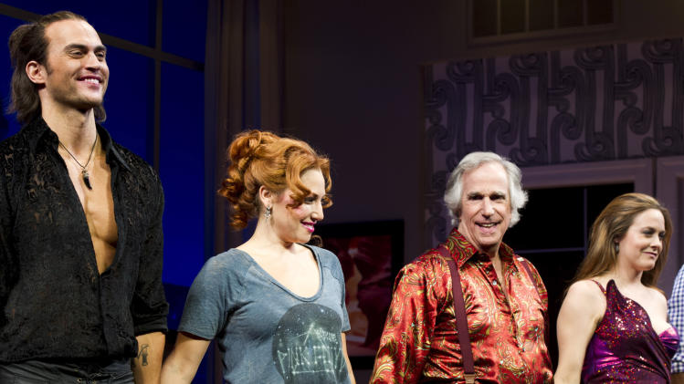 """From left, Cheyenne Jackson, Ari Graynor, Henry Winkler and Alicia Silverstone on stage at the curtain call for the opening night performance of the Broadway play, """"The Performers,"""" on Wednesday, Nov. 14, 2012, in New York. (Photo by Charles Sykes/Invision/AP)"""