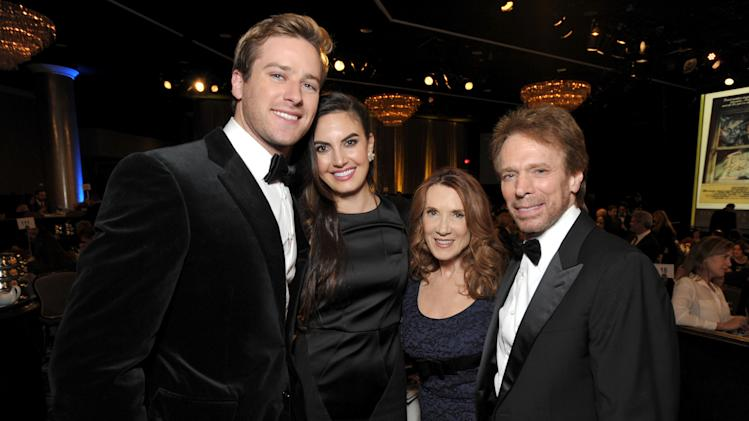 From left, Armie Hammer, Elizabeth Chambers, Linda Bruckheimer and Jerry Bruckheimer attend the presentation of the 27th Annual American Cinematheque Award to Jerry Bruckheimer on Thursday, Dec. 12, 2013, in Beverly Hills, Calif. (Photo by John Shearer/Invision for American Cinematheque/AP Images)