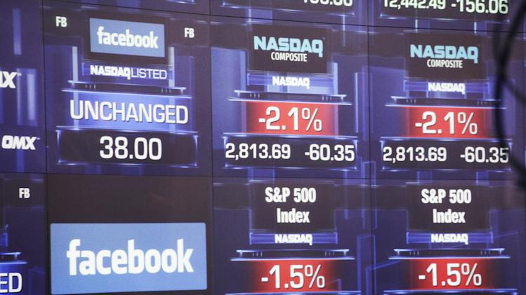 Electronic screens inside the Nasdaq stock market announce the listing of Facebook shares before the start of trading, Friday, May 18, 2012 in New York. The world's definitive online social network raised $16 billion in an initial public offering that values the company at $104 billion. (AP Photo/Mark Lennihan)