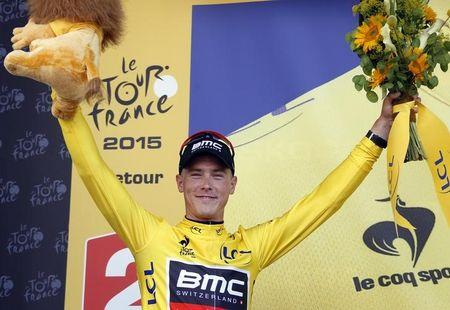 BMC Racing rider  Dennis of Australia wears the race leader's yellow jersey after winning the individual time-trial first stage of the Tour de France