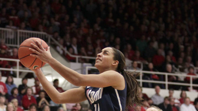 Connecticut guard Bria Hartley (14) drives to the basket past Stanford forward Joslyn Tinkle (44) during the first half of an NCAA college basketball game in Stanford, Calif., Saturday, Dec. 29, 2012. (AP Photo/Tony Avelar)