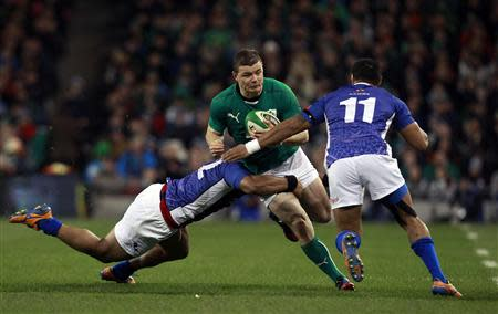 Ireland's Brian O'Driscoll is challenged by Samoa's John Leota in their international rugby union match at Aviva stadium in Dublin