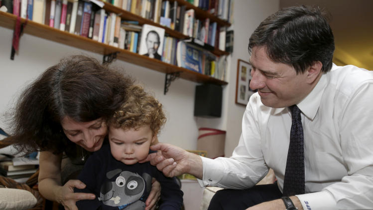 "In this Jan. 30, 2013 photo, Drew and Frances Pardus-Abbadessa play with their son Pavol, 1, at their apartment in New York, where they hope another son, from Kyrgyzstan, will one day  join them.  The Pardus-Abbadessa family were among a group initially known as the ""Kyrgyz 65"" - Americans who were in the process of adopting 65 orphans from the Central Asian republic when it suspended international adoptions in 2008 due to allegations of fraud. Some of the children were placed in domestic adoptions, and last summer nine of the remaining children finally were allowed to go to America. The Pardus-Abbadessas are now among 16 U.S. families still waiting, five years later. (AP Photo/Seth Wenig)"