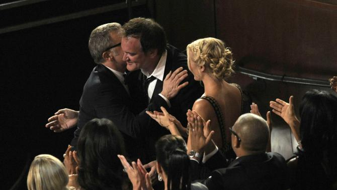 "Director Quentin Tarantino, right, hugs Christoph Waltz, left, after Waltz is announced as the winner of the award for best actor in a supporting role for ""Django Unchained"" during the Oscars at the Dolby Theatre on Sunday Feb. 24, 2013, in Los Angeles.  (Photo by Chris Pizzello/Invision/AP)"