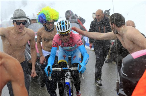 Italy's Vincenzo Nibali is cheered by supporters as he pedals on his way to win the 20th stage of the Giro d'Italia, Tour of Italy cycling race, from Silandro to Tre Cime di Lavaredo, Saturday May 25,