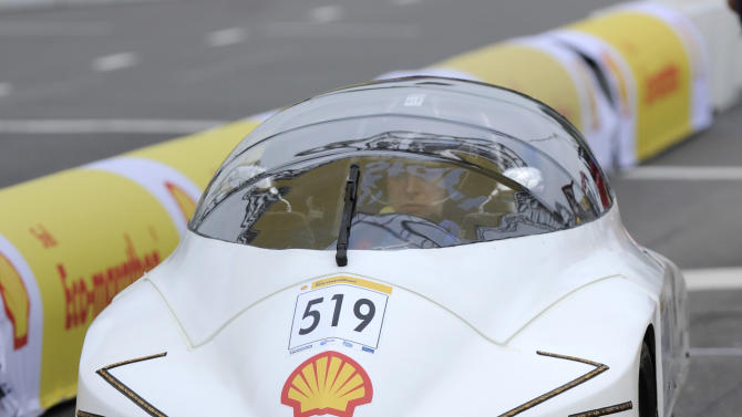 IMAGE DISTRIBUTED FOR SHELL - The PAKS, vehicle No. 519, UrbanConcept, running on Gasoline, competing for team SKAP from Warsaw University of Technology, Poland races during Day 2 of competition at the Shell Eco-marathon Europe at The Ahoy centre in Rotterdam, The Netherlands on Saturday, May 18, 2013. The car won first prize in the Gasoline category. Teams from universities all over Europe have brought their energy efficient cars to compete in the challenge. (Patrick Post/AP Images for Shell)