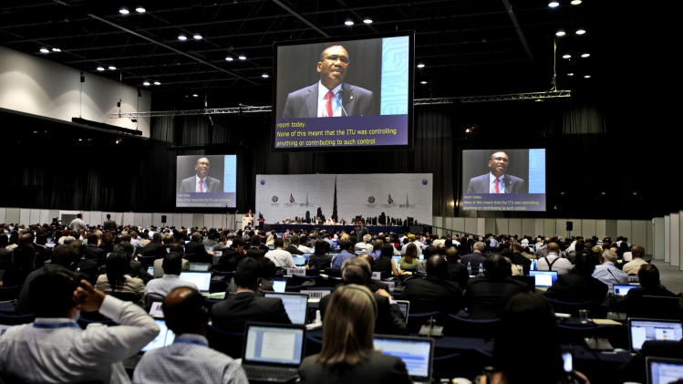 FILE - In this file photo dated Monday Dec. 3, 2012, participants listen to the speech of Hamdoun Toure, Secretary General of International Telecommunication Union, ITU, seen on screens, at the eleventh day of the World Conference on International Telecommunication in Dubai, United Arab Emirates. A U.N. conference weighing possible Internet rules shifted into high-stakes showdowns on Thursday after advancing a proposal for greater government oversight. The proposal was a blow to U.S.-led efforts to keep new regulations from touching the Net.(AP Photo/Kamran Jebreili, File)