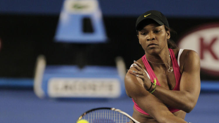 Serena Williams of the US makes a foehand return during a practice session for the Australian Open tennis championship in, Melbourne, Australia, Thursday, Jan. 12, 2012.(AP Photo/Mark Baker)