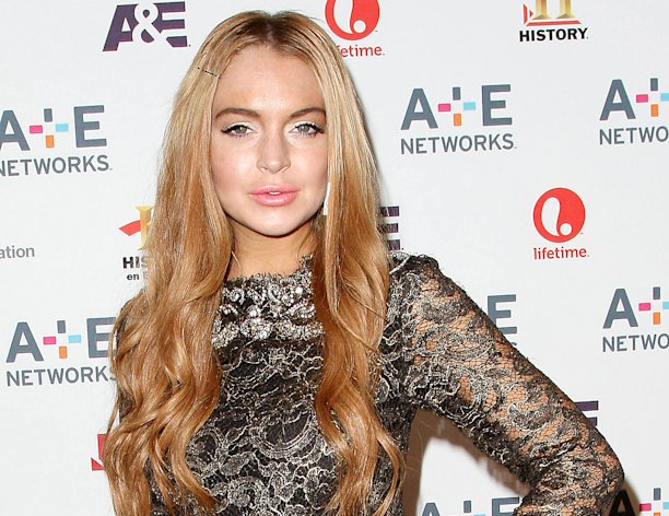 "In this May 9, 2012 photo shows actress Lindsay Lohan at the A&E Networks 2012 Upfront at Lincoln Center in New York. Lohan will star as Elizabeth Taylor in the upcoming Lifetime TV movie ""Liz & Dick."" Lohan has settled a lawsuit filed by three men who were in a sport utility vehicle the actress used to pursue a woman she believed was her assistant in 2008. The incident led to her second driving under the influence arrest that year. (AP Photo/Starpix, Kristina Bumphrey, file)"