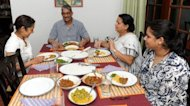 Former army chief Sarath Fonseka (C) having a dinner with his wife Anoma (C2) and daughters Aparna (R) and Apsara (L) following Fonseka&#39;s release from prison