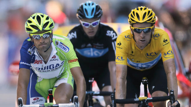 Vicenzo Nibali of Italy, left, Christopher Froome of Britain, and Bradley Wiggins of Britain, wearing the overall leader's yellow jersey, cross the finish line of the 16th stage of the Tour de France cycling race over 197 kilometers (122.4 miles) with start in Pau and finish in Bagneres-de-Luchon, France, Wednesday July 18, 2012. (AP Photo/Laurent Rebours)