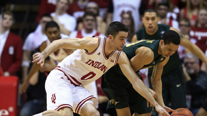 Indiana's Will Sheehey, left, and Michigan State's Travis Trice battle for a loose ball during the first half of an NCAA college basketball game on Sunday, Jan. 27, 2013, in Bloomington, Ind. (AP Photo/Darron Cummings)