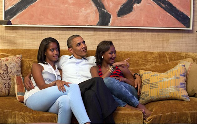 In this image released by the White House, President Barack Obama and his daughters, Malia, left, and Sasha, watch first lady Michelle Obama speak at the Democratic National Convention on television f