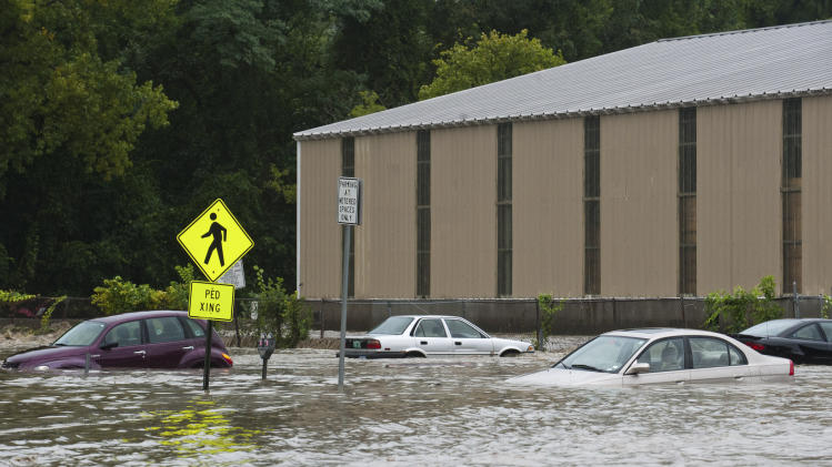 Cars in the parking lot at the bottom of Canal St. are submerged nearly to their windows by the flooding Whetstone Brook in Brattleboro, Vt. on Sunday, Aug. 28, 2011. The remnants of Hurricane Irene dumped torrential rains on Vermont on Sunday, flooding rivers and closing roads from Massachusetts to the Canadian border, putting parts of two towns underwater and leaving one young woman swept away and feared drowned in the Deerfield River. (AP Photo/The Brattleboro Reformer, Chris Bertelsen)