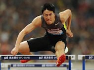 This file photo, taken on May 19, shows Liu Xiang of China winning the men's 110m hurdle event during the Diamond League athletics meet in Shanghai. Liu plans to celebrate his birthday by sending a warning to his Olympic rivals on his first appearance at the London Grand Prix on Friday. (AFP Photo/Peter Parks)