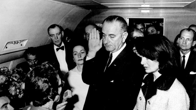 FILE - In this Nov. 22,1963, file photo, provided by the White House, Lyndon B. Johnson is sworn in as President of the United States in the cabin of Air Force One as Jacqueline Kennedy stands at his side. Judge Sarah T. Hughes, a Kennedy appointee to the Federal court, left, administers the oath. In background, from left are, Jack Valenti, admistrative assistant to Johnson; Rep. Albert Thomas, D-Tex.; Mrs. Johnson; and Rep. Jack Brooks, D-Tex. Jack Brooks was in the Dallas motorcade Nov. 22, 1963, when President John F. Kennedy was assassinated. Brooks, a Democrat who spent 42 years representing his Southeast Texas district, has died at age 89. (AP Photo/White House, Cecil Stoughton, File)