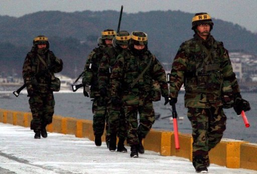 <p>South Korean marines patrol along the wharf on Yeonpyeong island near the maritime border between the two Koreas on December 17, 2010. The country's marines staged a live-fire exercise Wednesday near the disputed Yellow Sea border with North Korea amid high tensions over a display of front-line Christmas lights.</p>