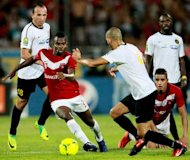 Etoile du Sahel's striker Jacob Meite (second left) vies for the ball with Esperance de Tunis' defender Walid Hichri (centre) and midfielder Wajdi Bouazzi (left) during their African Champions League football match at the Olympic Stadium in Sousse