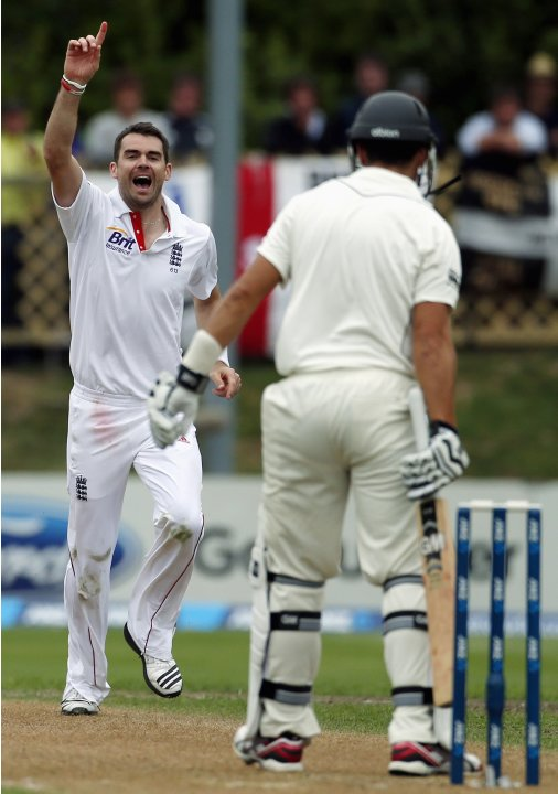 England's Anderson reacts after dismissing New Zealand's Taylor for 31 runs during the third day of the first test at the University Oval in Dunedin