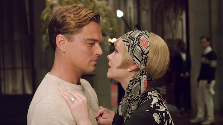 """This film publicity image released by Warner Bros. Pictures shows Carey Mulligan as Daisy Buchanan, right, and Leonardo DiCaprio as Jay Gatsby in a scene from """"The Great Gatsby."""" (AP Photo/Warner Bros. Pictures)"""
