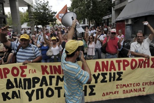 <p>Greek municipal workers protest near the Finance Ministry in Athens on Wednesday. Anti-austerity protests Wednesday clogged Athens as the government struggled to finalise additional cutbacks with its creditors and sought to jumpstart a privatisation drive delayed for months.</p>