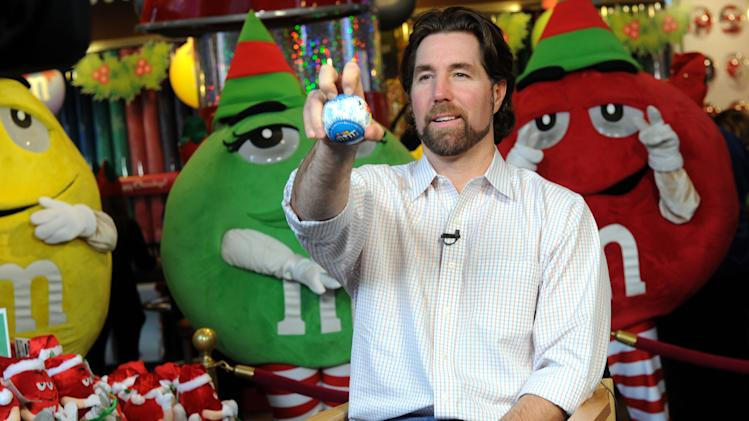 IMAGE DISTRIBUTED FOR M&M's WORLD - Cy Young Award winning pitcher R.A. Dickey displays his famous knuckleball during the unveiling of the new Holiday Village at M&M's World in New York, Tuesday, Dec. 11, 2012.  The new M&M's World Holiday Village offers a variety of seasonal-themed merchandise including dispensers, clothing, ornaments and holiday-themed M&M's Brand Chocolate Candies. (Diane Bondareff/Invision for M&M's World/AP Images)