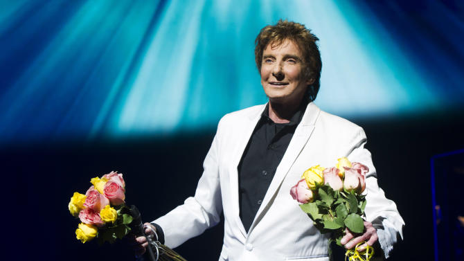 "FILE - This Jan. 29, 2013 file photo shows Barry Manilow at the opening night curtain call for""Manilow on Broadway"" in New York. The Man Who Makes the Whole World Sing is used to far bigger venues than the 1,710-seat St. James Theatre, one of the smaller theaters on the Great White Way. (Photo by Charles Sykes/Invision/AP, file)"