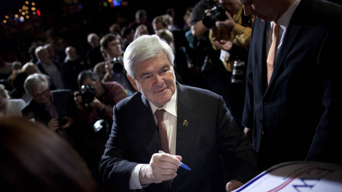 Republican presidential candidate, former House Speaker Newt Gingrich signs autographs at Stoney's Rockin Country, Friday, Feb. 3, 2012, in Las Vegas, Nev.  (AP Photo/Evan Vucci)