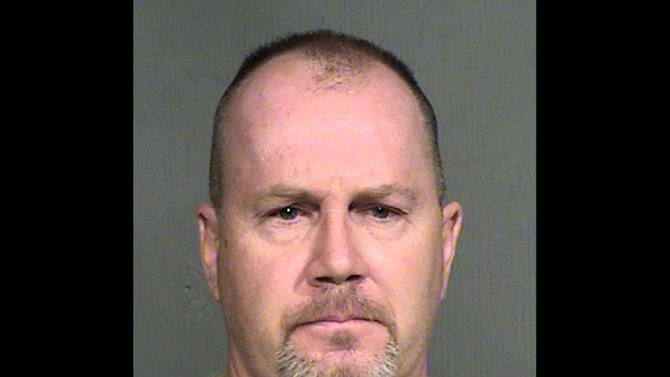 This booking photo provided by the Maricopa County Sheriff shows Richard Malley. Malley, 49, was arrested over the weekend for pointing a rifle at a Maricopa County sheriff's deputy he apparently mistook for a drug smuggler. He was released on $10,000 bail and is set for a court appearance on Aug. 26. (AP Photo/Maricopa County Sheriff)