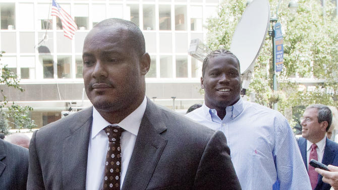 New Orleans Saints defensive lineman Will Smith, left, and Green Bay Packers defensive lineman Anthony Hargrove arrive at the National Football League's headquarters, Monday, June 18, 2012 in New York. Smith and Hargrove and two other players are appealing their suspensions for their role in the Saints bounty program. (AP Photo/Mark Lennihan)