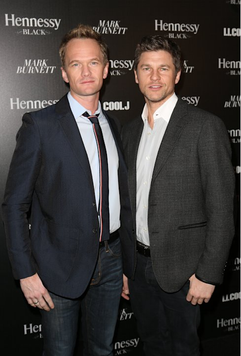 Neil Patrick Harris, left, and David Burtka attend Hennessy Black: A Dinner with LL Cool J and Mark Burnett Celebrating Music's Biggest Night Out, on Sat., Feb., 9, 2013 in Los Angeles. (Photo by Case