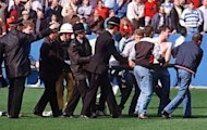 <p>File photo shows policemen rescuing soccer fans at Hillsborough stadium on April 15, 1989, when 96 fans were crushed to death and hundreds injured after support railings collapsed during a match between Liverpool and Nottingham Forest.</p>
