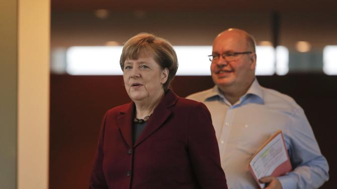 German Chancellor Merkel and her chief-of-staff Altmaier walk in the Chancellery in Berlin