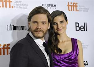 "Cast member Daniel Bruehl poses on the red carpet with girlfriend Felicitas Rombold before a screening of the film ""Rush"" during the 38th Toronto International Film Festival in Toronto"