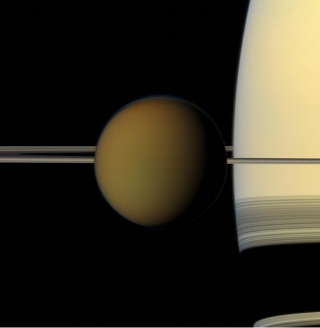 This undated true color image by the Cassini spacecraft released by NASA shows Saturn's largest moon, Titan, passing in front of the planet and its rings. A new study released Thursday, June 28, 2