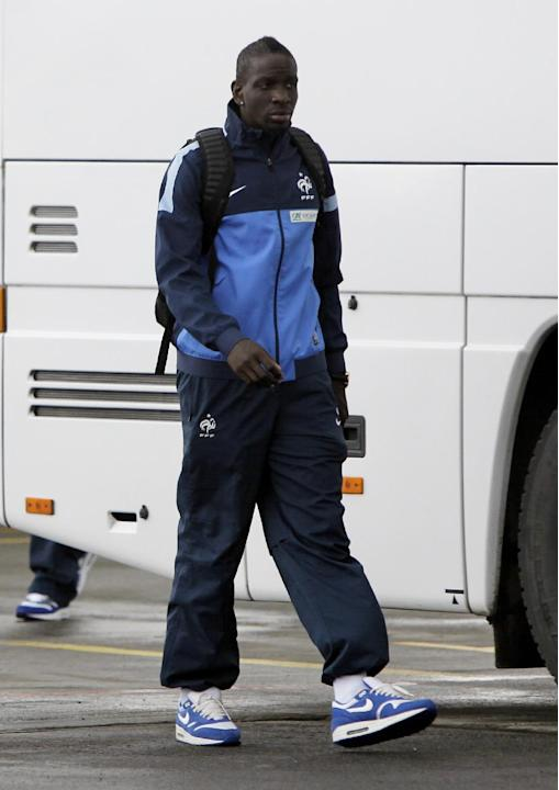 France's national soccer team player Mamadou Sakho arrives at the Kiev airport ahead of their 2014 World Cup qualifying playoff soccer match against Ukraine  in Kiev, Ukraine, Thursday, Nov. 14, 2013