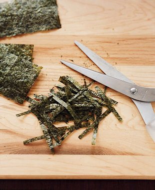 Sprinkle seaweed and scallions