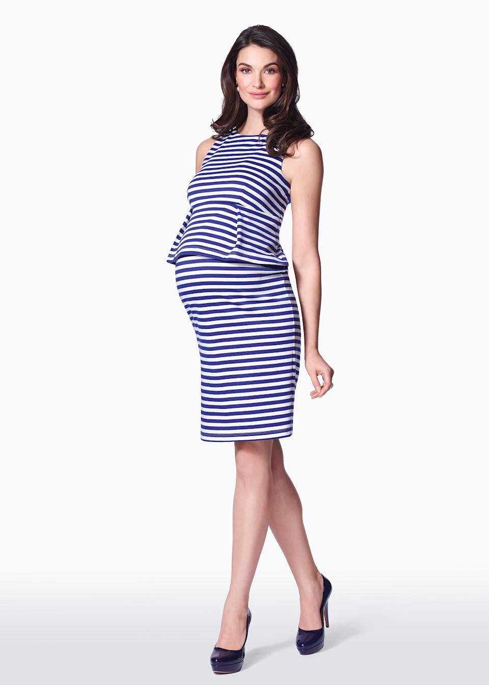 This product image released by maternity clothing company Pea in the Pod shows a two piece striped top and skirt set. Fashion experts say a streamlined style best suits a baby bump. (AP Photo/Pea in the Pod)
