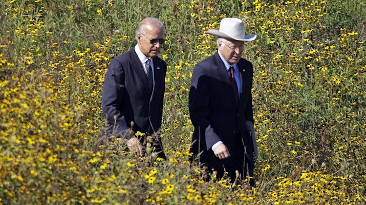 Vice President Joe Biden, left, and Interior Secretary Ken Salazar arrive at the Flight 93 National Memorial in Shanksville, Pa., for a memorial service, Tuesday, Sept. 11, 2012. (AP Photo/Gene J. Puskar)