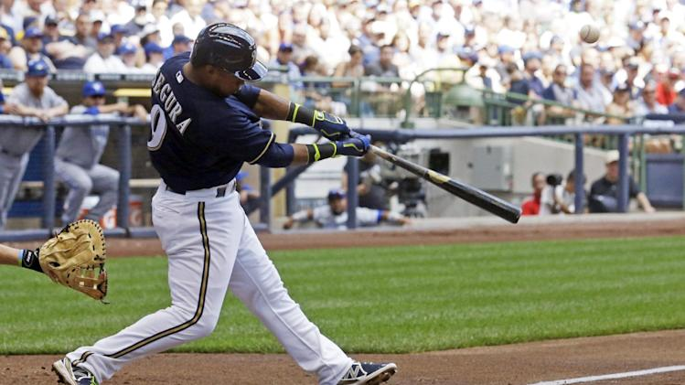 Milwaukee Brewers' Jean Segura hits an RBI double during the second inning of a baseball game against the Toronto Blue Jays Wednesday, Aug. 20, 2014, in Milwaukee. (AP Photo/Morry Gash)