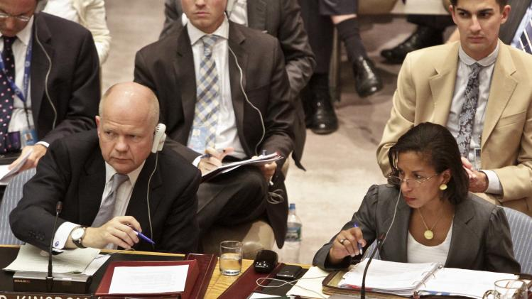 William Hague, right, U.K. Foreign Minister, and Susan Rice, U.S. Ambassador to the U.N., listens during a meeting on Syria in the United Nations Security Council on Thursday, Aug. 30, 2012.  Turkey's foreign minister urged the Security Council on Thursday to set up a safe zone in Syria to protect thousands of civilians fleeing the civil war.  (AP Photo/Bebeto Matthews)