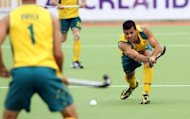 Christopher Ciriello (R) of Australia at the men's hockey Champions Trophy in Auckland in December 2011. The Australian men's field hockey team has won an appeal after the world's number one side was handed three early morning starts in their group matches at the London Olympics