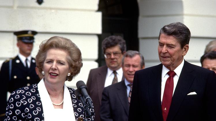 FILE - In a Friday, July 17, 1987 file photo, Prime Minister Margaret Thatcher of the United Kingdom, left, makes remarks after visiting United States President Ronald Reagan, right, at the White House in Washington, D.C. Thatchers former spokesman, Tim Bell, said that the former British Prime Minister Margaret Thatcher died Monday morning, April 8, 2013, of a stroke. She was 87. (AP Photo/DPA, Howard L. Sachs, File)